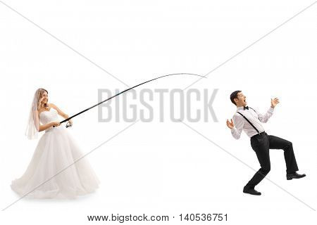 Young bride fishing with a rod and catching a groom isolated on white background