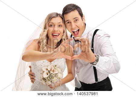 Young newlywed couple making a heart gesture with their hands isolated on white background