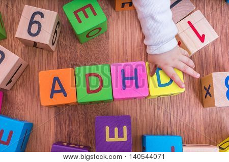 Adhd Concept. Baby Is Playing With Cubes With Letters.