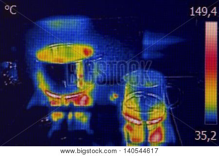 Infrared thermovision image showing cooking on a gas stove