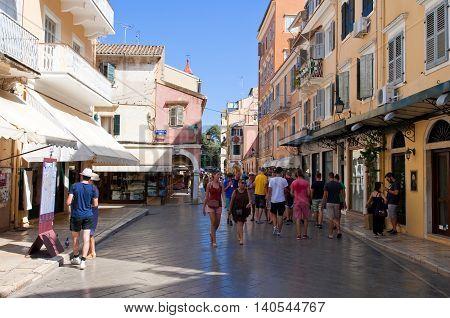 CORFU-AUGUST 24: Tourists go shopping on Corfu island on August 242014 in Kerkyra town Greece. Corfu is a Greek island in the Ionian Sea.