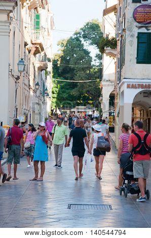 CORFU-AUGUST 27: Kerkyra shadow street in the old town tourists go shopping on August 27 2014 on Corfu island Greece.