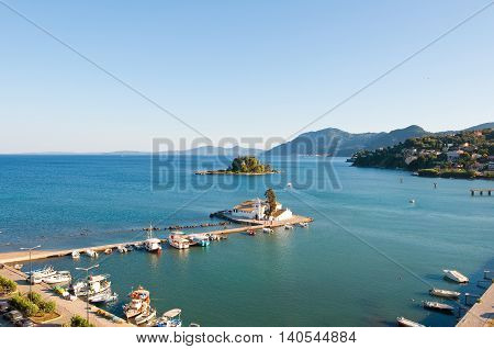 Panorama of Chalikiopoulou Lagoon and Pontikonisi and Vlacheraina monastery seen from the hilltop of Kanoni on the island of Corfu Greece. poster
