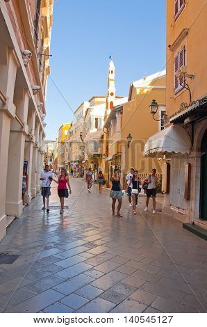 CORFU-AUGUST 22: Kerkyra street in the old part of the city with the row of souvenirs shops on August 22 2014 on Corfu island Greece.