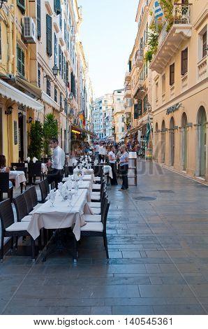 CORFU-AUGUST 22: Venetian Kerkyra city local restaurants invite tourists to have dinner on August 22 2014 on Corfu island Greece.
