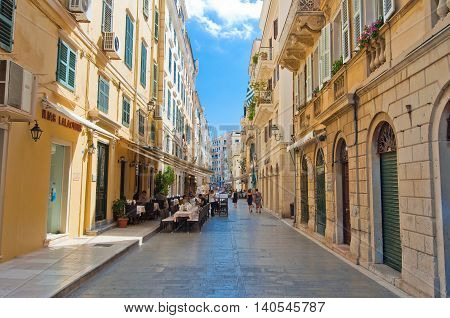 CORFU-AUGUST 22: Venetian architecture in Kerkyra with the row of local restaurants on August 22 2014 on Corfu island Greece.