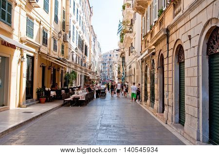CORFU-AUGUST 22: Venetian architecture in Kerkyra city with the row of local restaurants on August 22 2014 on Corfu island Greece.