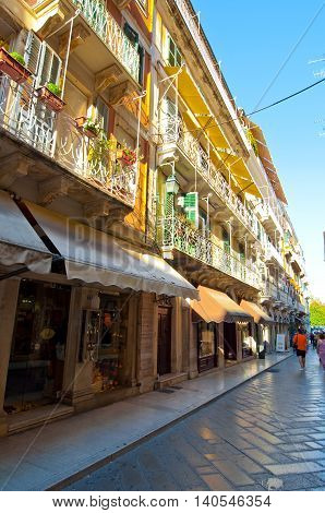 CORFU-AUGUST 27: Kerkyra narrow street in the old town with the row of souvenirs shops on August 27 2014 on the Corfu island Greece.