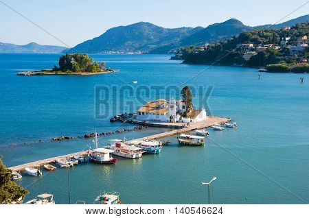 Pontikonisi and Vlacheraina monastery on the south of Corfu town from the hilltop of Kanoni on the island of Corfu Greece. poster