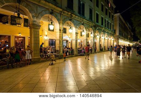 CORFU-AUGUST 22: The Liston of Corfu at night in Kerkyra city with the row of local restaurants on August 22 2014 on Corfu island in Greece.