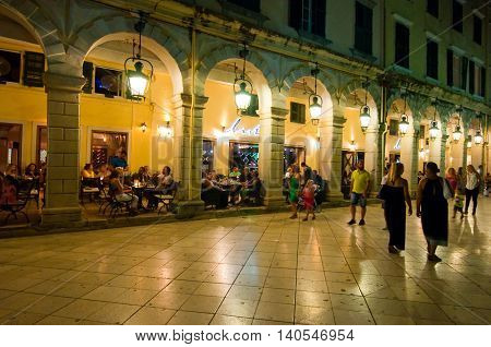 CORFU-AUGUST 22: The Liston of Corfu at night in Kerkyra city with the row of local restaurants and crowd of people on August 22 2014 on Corfu island in Greece.