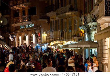 CORFU-AUGUST 25: Crowd of people on Kerkyra street at night on August 25 2014 in Kerkyra town on the Corfu island Greece.