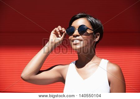 Young Stylish Charismatic African Woman Trying Her New Contemporary Fashionable Round-shaped Sunglas