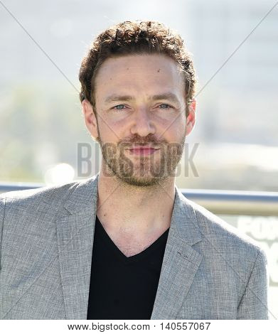 LOS ANGELES - JUL 22:  Ross Marquand arrives to the Comic Con 2016 - The Walking Dead PhotoCall on July 22, 2016 in San Diego, CA
