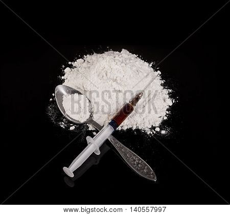 Drug Powder, Drug Syringe And Drug On Spoon Close-up On A Black Background.