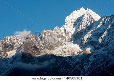 View of Thamserku Peak above Dudh Koshi valley from Khumjung Solukhumbu Nepal.