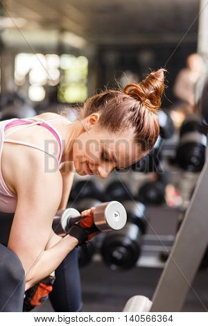 Young Woman Doing Exercise In Fitness Center