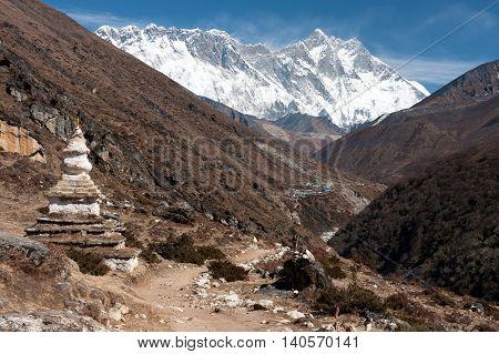 View of stupa at Pangboche with Mt. Everest Nuptse to Lhotse ridge and upper Imja Khola valley in the background Pangboche Solukhumbu Nepal.