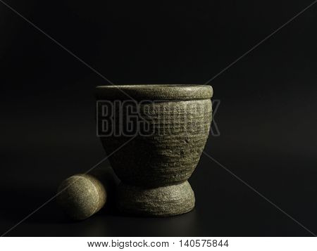 mortar on a black background .The light from the right of the image.