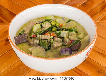 Green curry chicken in coconut milk. isolated on white background .