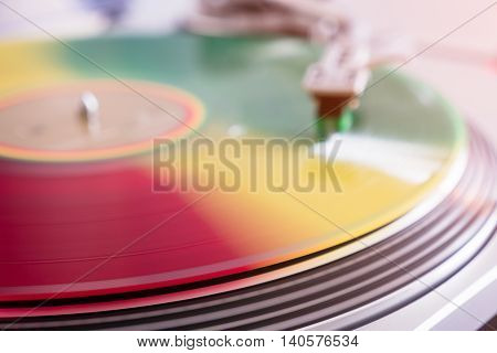 colorful vinyl record on the vintage player