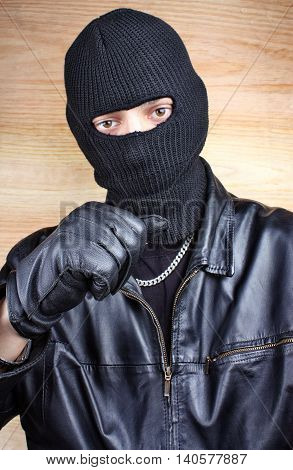 Masked thief in balaclava bandit gangster bandit