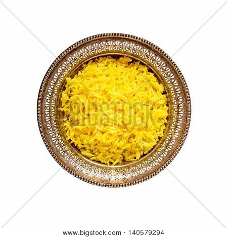 Top view of an antique metal bowl with cooked turmeric jasmine rice isolated on white