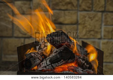iron brazier with burning coals and flame