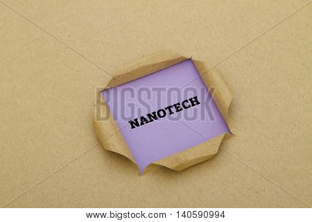 Nanotech word written under torn paper .