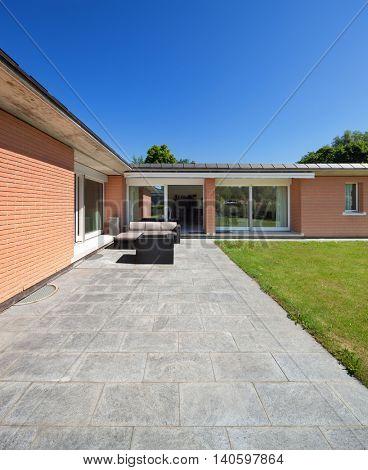 Architecture, veranda of a brick house, outdoors