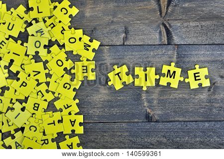Puzzle pieces with word Time