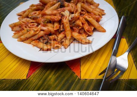 Primavera vegetable penne with Italian puttanesca spaghetti sauce