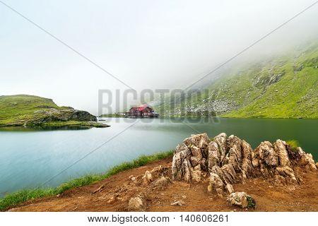 Glacial lake misty morning.The Balea Glacial Lake on Fagaras Romania