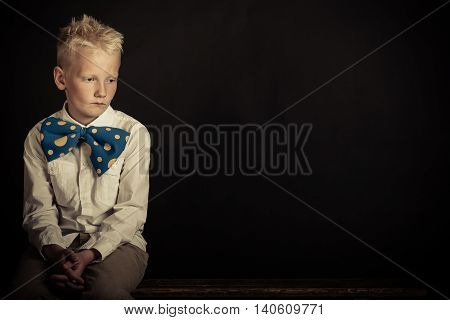 Sad Boy In Oversized Bowtie With Copy Space