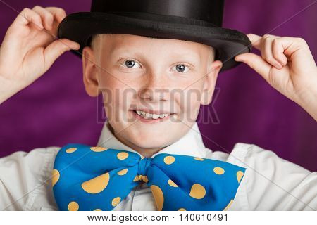 Jaunty Young Boy In A Bow-tie And Top Hat