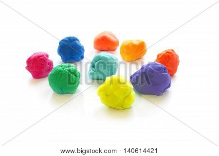 Three Modelling clay balls of different colors isolated on a white background