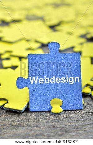Puzzle pieces with word Webdesign