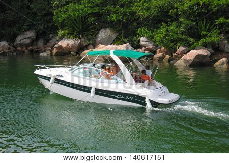 Florianopolis, Santa Catarina, Brazil - April 15, 2006: A family on a motorboat leaving the Barra Da Lagoa channel at Florianopolis, Santa Catarina - Brazil