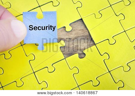 Puzzle pieces with word Security