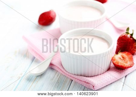 Strawberry Yogurt In Bowl On A Blue Wooden Table
