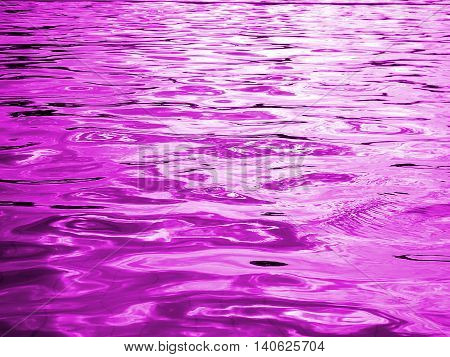 reflection of light on the waves , purple water and light from the sun in pool ,water level, purple abstract background