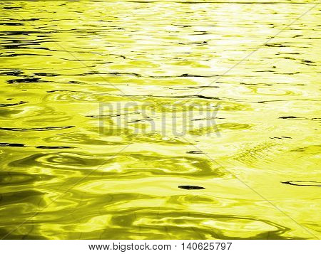 reflection of light on the waves ,Yellow water and light from the sun in pool ,water level ,Yellow abstract background