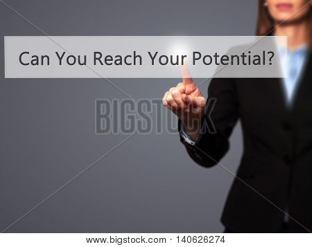 Can You Reach Your Potential ? - Businesswoman Pressing High Tech  Modern Button On A Virtual Backgr