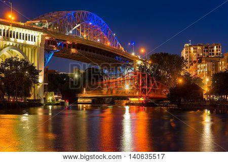 The Center Street Swing bridge moves back into place over the river after allowing a boat to pass with motion blur from the movement