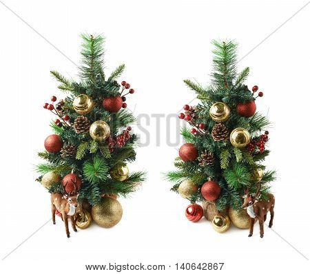 Tiny christmas tree decorated with balls and tiny deer statuette, composition isolated over the white background, set of two different foreshortenings