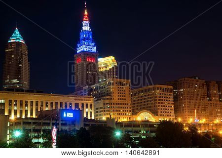 CLEVELAND OH - MAY 28 2016: View of Cleveland's three tallest buildings--the Key Tower the Terminal Tower and the BP building--lit up at night above the riverfront district.