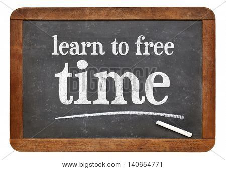 learn to free time - white chalk text on a vintage slate blackboard