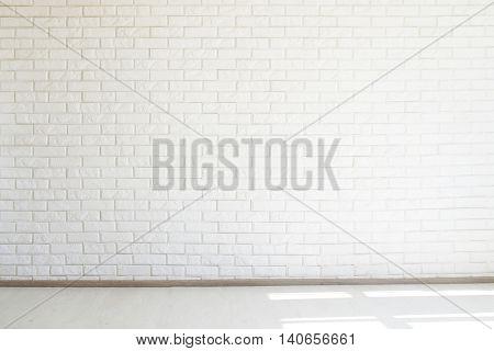 White brick wall, free space, white floor, soft light