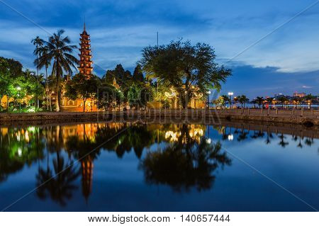 Tran Quoc Pagoda, the oldest Buddhist temple in Hanoi, is located on a small island near the southeastern shore of Hanoi's West Lake, Vietnam.