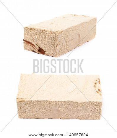 Briquette of a caramel ice cream isolated over the white background, set of two different foreshortenings